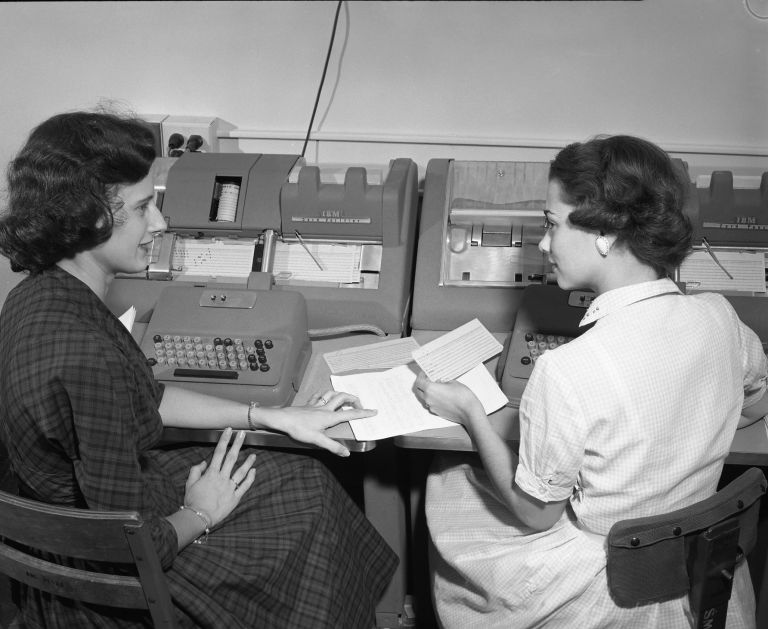 Two women keypunching at Text AM mainframe, black and white photo.